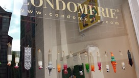 The right Condomerie window features colorful and whimsical condoms.