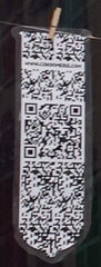 A condom with a QR code on it.
