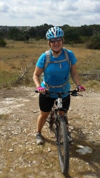 Promise: Trail loving Austin adventurer with a mountain bike.