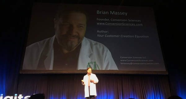 Brian Massey on Stage at Digital Summit Denver in Lab Coat